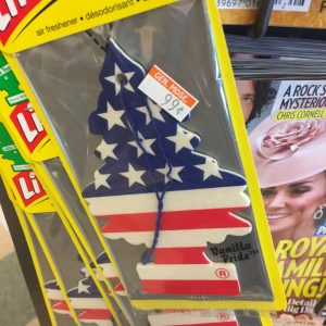 An American flag-pattern air freshener next to a magazine cover of Kate Middleton
